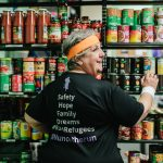 Sister Rita Malavisi stacking the shelves in the ASRC Foodbank.