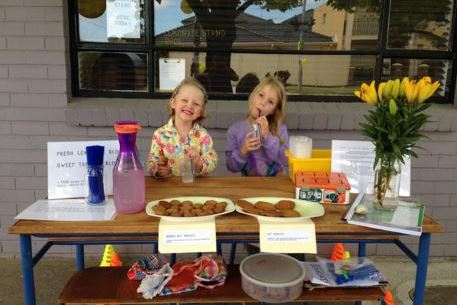 Child fundraisers Dot and April and the stall