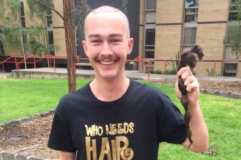 ASRC fundraiser with shaved head