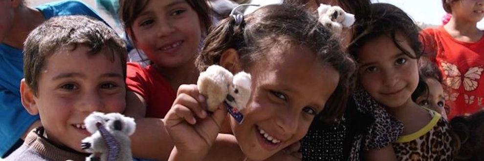 refugee kids with koala toys